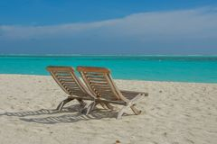 Beautiful topical view of the beach with wooden chairs. At Maldives Stock Photography