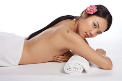 Beautiful topless Asian woman at a spa Royalty Free Stock Images