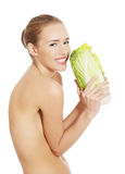 Beautiful topless caucasian woman with iceberg lettuce. Royalty Free Stock Image