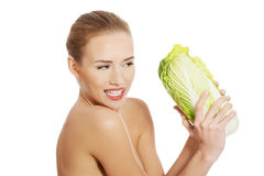 Beautiful topless caucasian woman with iceberg lettuce. Stock Photos