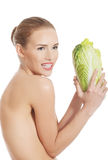 Beautiful topless caucasian woman with iceberg lettuce. Stock Photography