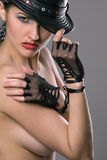 Beautiful topless model with hat and gloves Stock Images