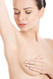 Beautiful topless woman with covered breasts. Stock Photography