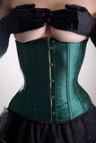 Beautiful topless woman in green corset Royalty Free Stock Images