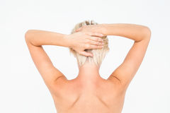 Beautiful topless woman touching her hair Royalty Free Stock Image