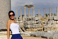 Beautiful tourist in ancient ruins. Pretty tourist at ancient ruins Stock Image