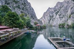 Beautiful tourist attraction Lake Matka in Skopje Macedonia. Beautiful tourist attraction Lake Matka in Skopje Macedonia with restaurant and canoes surrounded Stock Photos