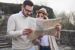 Beautiful couple traveling and sightseeing. Beautiful tourist couple in love traveling and sightseeing Stock Photography