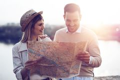 Beautiful couple traveling and sightseeing. Beautiful tourist couple in love traveling and sightseeing Royalty Free Stock Photo