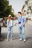 Beautiful Tourist Couple In Love Walking On Street Together. Happy Young Man And Smiling Woman Walking Around Old Town Streets, Lo Stock Photography