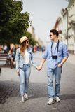 Beautiful Tourist Couple In Love Walking On Street Together. Happy Young Man And Smiling Woman Walking Around Old Town Streets, Lo royalty free stock photos