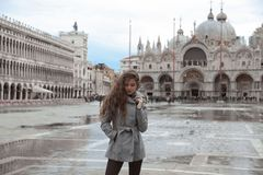 Beautiful tourist girl with long wavy hair in Piazza San Marco i Royalty Free Stock Images