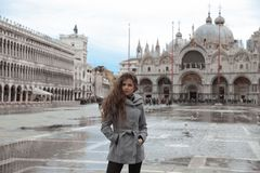Beautiful tourist girl with long wavy hair in San Marco square i Stock Image