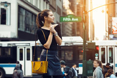 Beautiful tourist girl traveling and enjoying busy city life of New York City. Lifestyle shoot of travel blogger girl on city street Stock Photos