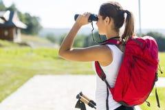Beautiful tourist hiking and using binoculars Royalty Free Stock Photos