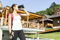 Beautiful tourist hiking and using binoculars Royalty Free Stock Images