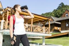 Beautiful tourist hiking and using binoculars Royalty Free Stock Images