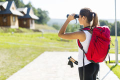Beautiful tourist hiking and using binoculars Stock Images