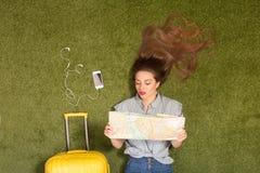 Beautiful tourist lady lying on green grass Stock Photos