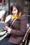Beautiful tourist in Paris sending sms Stock Images