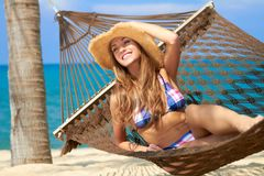 Beautiful tourist relaxing in a hammock Stock Images