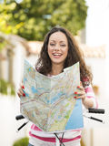 Beautiful tourist searching on the map Stock Photography