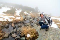 Rila lakes stream tourism in the fog royalty free stock image