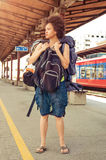 Beautiful tourist traveler standing with huge luggage Royalty Free Stock Images