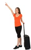 A beautiful tourist woman with baggage showing sign isolated on Royalty Free Stock Photo