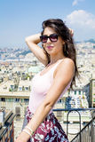 Beautiful tourist woman looking to Genova port from balcony over the city Royalty Free Stock Photography