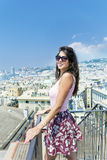 Beautiful tourist woman looking to Genova port from balcony over the city Royalty Free Stock Photos