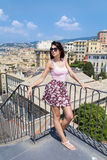 Beautiful tourist woman looking to Genova  town Stock Images