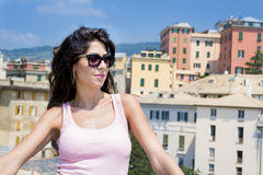 Beautiful tourist woman looking to Genova  town Royalty Free Stock Images