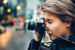 Free Beautiful Tourist Woman Taking Photo With Vintage Old Camera In The City Stock Image - 102772511
