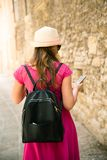 A beautiful touristic girl on phone in San Marino, travel and va. Cation royalty free stock image