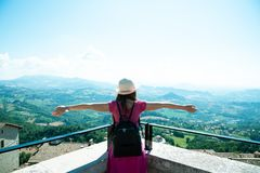A beautiful touristic girl in the San Marino, admiring the view. stock photo
