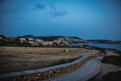 Beautiful town in the evening. S`Archittu town in the evening with walking path visible. Captured in S`Archittu, Oristano province, Sardinia, Italy Royalty Free Stock Image