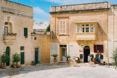Beautiful town square of Mdina, Malta. Mdina, Malta - March 10 2017: Beautiful town square with traditional maltese houses in historic old city. Silent City Stock Photos