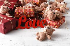Beautiful toy bears on wooden background with gift box, shabby c. Hic idea with Teddy bears Royalty Free Stock Photos