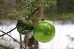 Beautiful toys for Cristmas tree in the forest Stock Photos