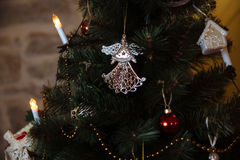 Beautiful toys and gifts on X-mas tree. Concept of Happy New Year Stock Photo