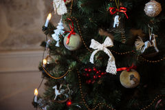 Beautiful toys and gifts on X-mas tree. Concept of Happy New Year Royalty Free Stock Image