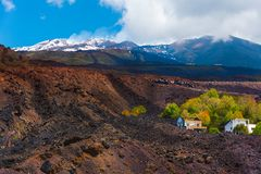 Beautiful traces of Etna`s eruption. Ruins of a house kept between the lava flows in one of the lasts eruptions of Etna royalty free stock photos