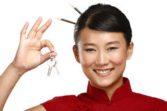 Beautiful traditional asian chinese woman showing flat keys Stock Photos