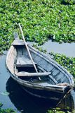 Traditional boat parked around a pond water royalty free stock photography