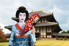 Geisha Girl, Japanese, Japan Woman. A beautiful traditional geisha girl or woman with a Japanese temple in the background. People in Japan are rich in tradition Royalty Free Stock Photos