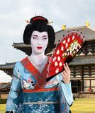 Geisha Girl, Japanese, Japan Woman. A beautiful traditional geisha girl or woman with a Japanese temple in the background. People in Japan are rich in tradition Stock Image