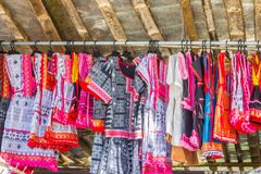 Beautiful traditional handmade clothes for sale to the tourist as the souvenir at the local market in hill tribe minority village. At northern Thailand stock images