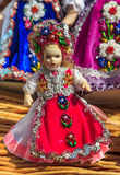 Beautiful traditional handmade doll and colorful skirt. Romanian traditional colorful handmade doll Stock Photo
