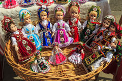 Beautiful traditional handmade dolls and colorful dresses. Romanian traditional colorful handmade dolls Stock Photo